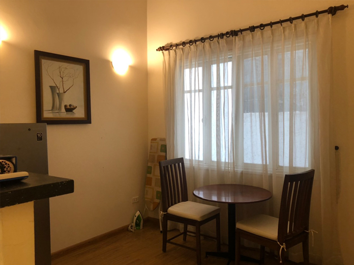 One bedroom with wooden floors, modern facilities at Dang Thai Mai