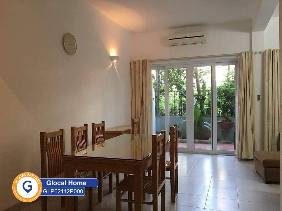 1-bedroom apartment with large glass doors and lots of trees in Nhat Chieu