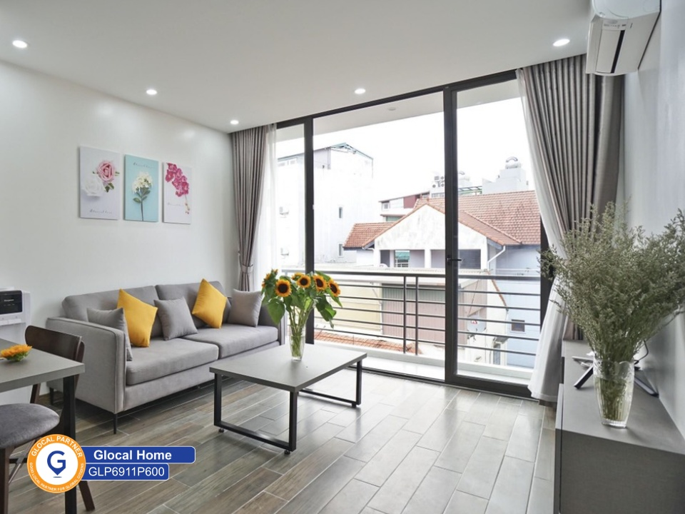 One-bedroom apartment with many windows, dark color furniture in To Ngoc Van street