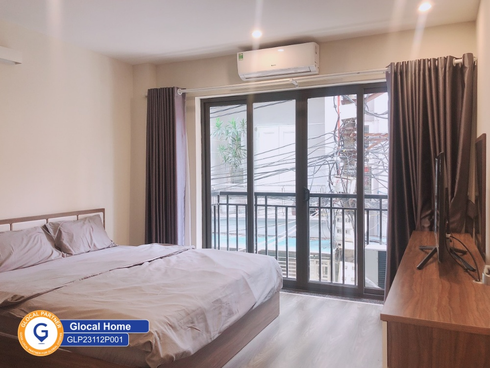 One-bedroom apartment with wooden floors, many windows in Nhat Chieu