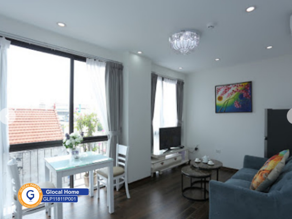 Modern 1 bedroom apartment with white tone and balcony in To Ngoc Van street